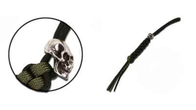 Skull Trinket w/Black and Green Lanyard